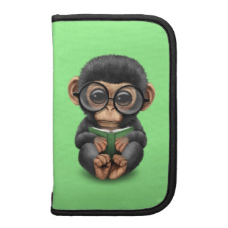 Cute Baby Chimpanzee Reading a Book on Green Organizers