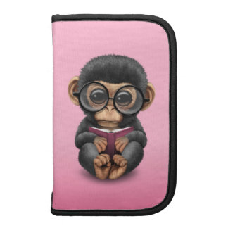 Cute Baby Chimpanzee Reading a Book on Pink Organizers