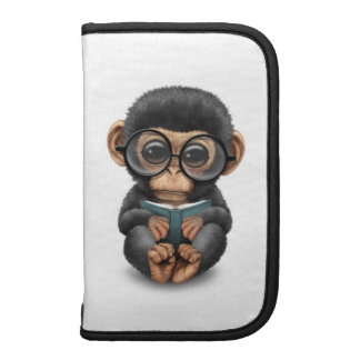 Cute Baby Chimpanzee Reading a Book on White Planners