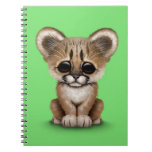 Cute Baby Cougar Cub on Green Notebook
