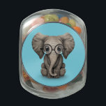 "Cute Baby Elephant Calf with Reading Glasses Glass Candy Jar<br><div class=""desc"">This cute design features a small baby elephant with large ears and deep black eyes. The calf is sitting with its front legs beside each other and is looking forward with its trunk hanging down. The over sized head and small body along with the details in the skin create a...</div>"