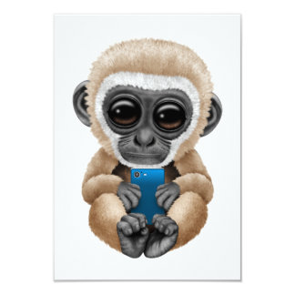 Cute Baby Gibbon Holding a Blue Cell Phone Card