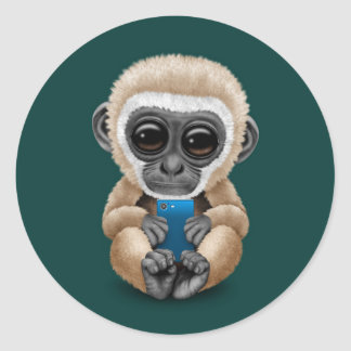 Cute Baby Gibbon Holding a Cell Phone Teal Classic Round Sticker
