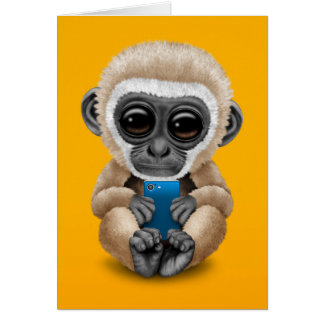 Cute Baby Gibbon Holding a Cell Phone Yellow Card