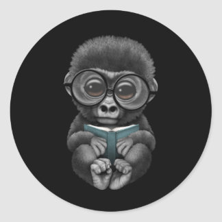 Cute Baby Gorilla Reading a Book on Black Classic Round Sticker