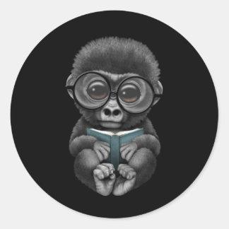 Cute Baby Gorilla Reading a Book on Black Classic Round Sticker