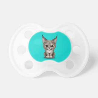 Cute Baby Lynx Cub on Blue Pacifiers