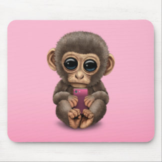 Cute Baby Monkey Holding a Cell Phone Pink Mouse Pad