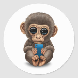 Cute Baby Monkey Holding a Cell Phone White Classic Round Sticker