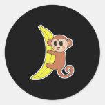 cute baby monkey on banana classic round sticker