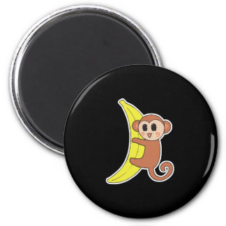 cute baby monkey on banana magnet