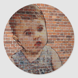 Cute baby on brick wall. classic round sticker