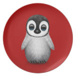 Cute Baby Penguin on Deep Red Plate