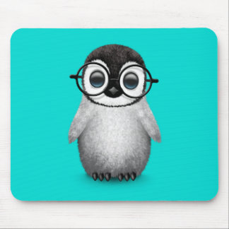 Cute Baby Penguin Wearing Eye Glasses on Blue Mouse Pad