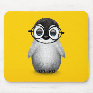 Cute Baby Penguin Wearing Eye Glasses on Yellow Mouse Pad