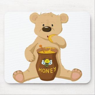 Cute bear eating honey mouse pad