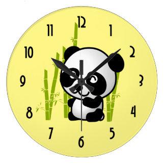 Cute black and white panda bear in a bamboo grove. clocks