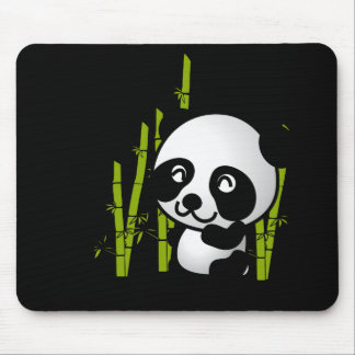 Cute black and white panda bear in a bamboo grove. mouse pad