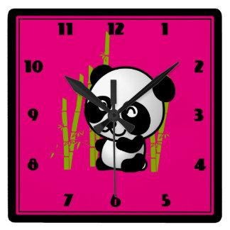 Cute black and white panda bear in a bamboo grove. square wall clock
