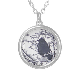 Cute black bird in snowy branches round pendant necklace