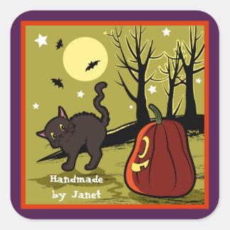 Cute black cat frighten by a pumpkin square sticker