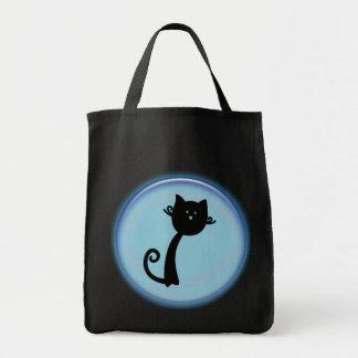 Cute black cat in blue circle grocery tote bag