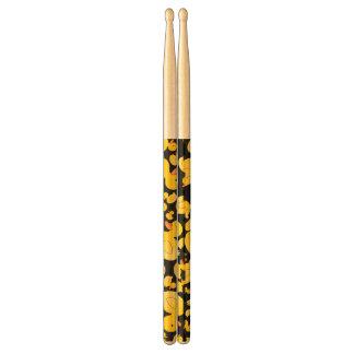 Cute black rubber ducks drum sticks
