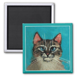 Cute blue-eyed cat magnet