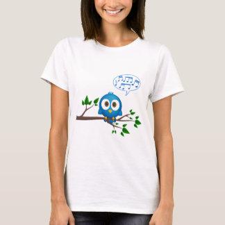 Cute blue twitter bird cartoon on woman's shirt