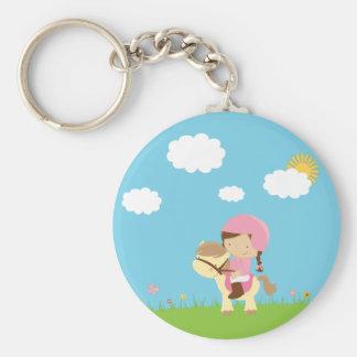 Cute brown hair girl riding a horse keychain