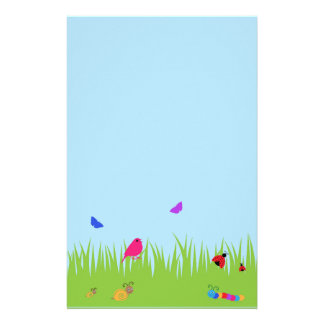 Cute bugs and bird in grass with blue sky stationery