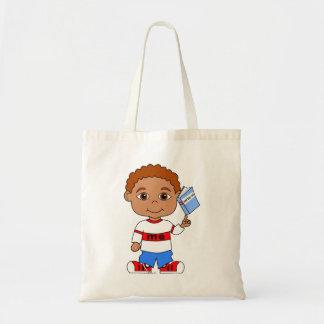 cute cartoon boy holding a book tote bag