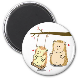 Cute Cartoon Hedgehog couple in love at tree swing 2 Inch Round Magnet
