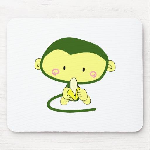 Cute Cartoon Monkey Eating A Banana Mousepads
