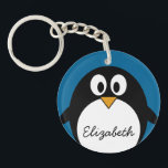 "cute cartoon penguin with blue background keychain<br><div class=""desc"">A simple,  yet mod drawing of a penguin. If you need to make changes to the artwork,  click on the customize it button to move things around.</div>"