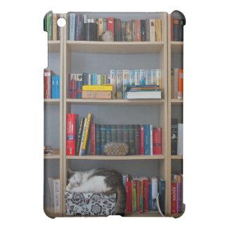 Cute cat sleeping on bookshelf library books iPad mini cases