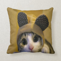 Cute Cat with Big Eyes in a Dressed of Animal Ears Throw Pillow (<em>$33.60</em>)