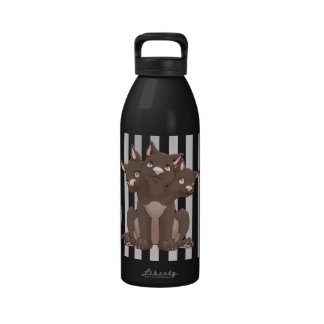 Cute cerberus puppy drinking bottles