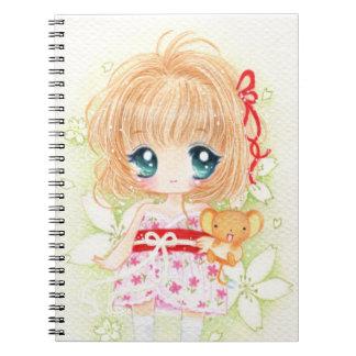 Cute chibi girl with kawaii plushie spiral notebook