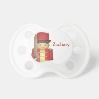Cute Christmas Toy Soldier Boy in Red Pacifier
