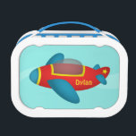 """Cute Colourful Aeroplane Jet for Kids Lunch Box<br><div class=""""desc"""">A cartoon of a cute and colourful aeroplane jet in red,  blue and yellow with space for name personalisation for your child. An attractive design for the little ones who love aircraft,  planes and aviation stuff.</div>"""