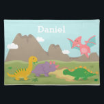 """Cute Colourful Dinosaurs For kids Cloth Placemat<br><div class=""""desc"""">A cute and colourful dinosaur dinner placemat to keep young kids occupied at meal times. It comes with cartoon dinosaurs, a yellow Brachiosaurus munching on leaves, a purple Triceratops, a green Stegosaurus and a pink Pterodactylus. Background of mountains and clouds. This attractive design is great for kids who love Jurassic,...</div>"""