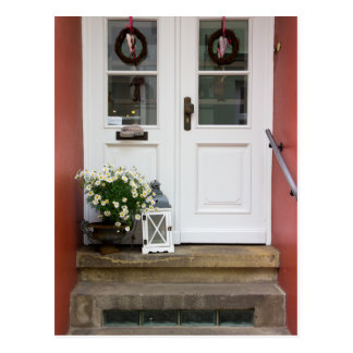 Cute Cottage Door With A Lamp and Flowers Postcard