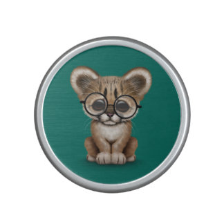 Cute Cougar Cub Wearing Eye Glasses on Teal Blue Speaker