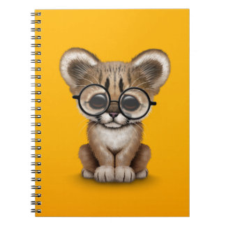 Cute Cougar Cub Wearing Eye Glasses on Yellow Note Books