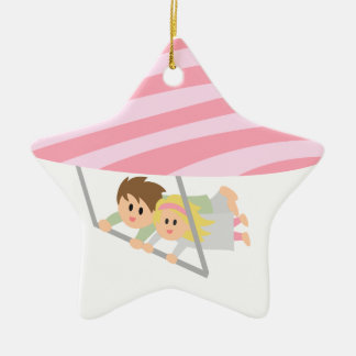 Cute couple flying on a heart-shaped hang-glider ceramic ornament