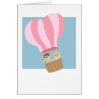 Cute couple in hot air balloon greeting card