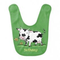 Cute cow in green field cartoon illustration baby bib