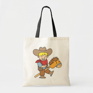 Cute cowboy riding on a horse stick tote bag