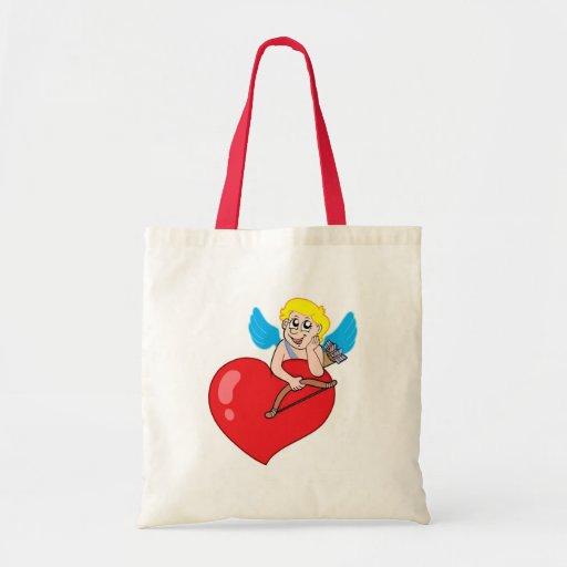 Cute Cupid resting on heart Tote Bag